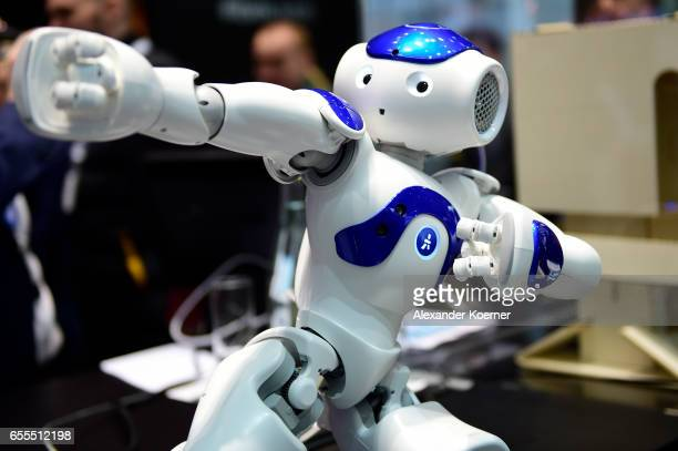 The robot Nao performs Tai Chi at the IBM stand at the CeBIT 2017 Technology Trade Fair on March 20 2017 in Hanover Germany Nao has a face detection...