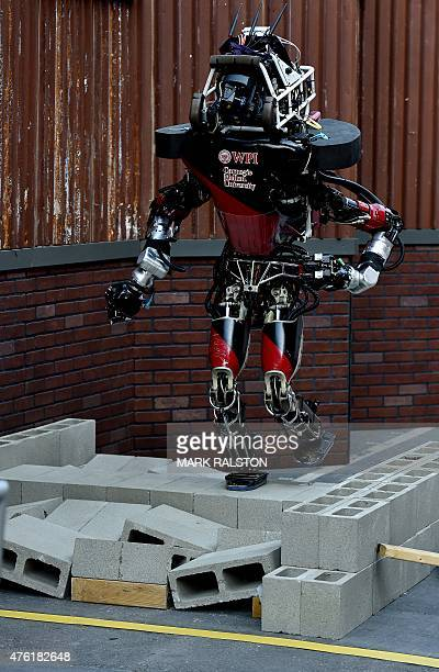 The robot 'Warner' developed by Team WPICMU from the US steps over an uneven obstacle during the finals of the DARPA Robotics Challenge at the...