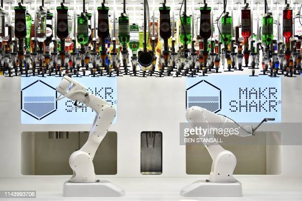 The robotic arms of the Makr Shakr cocktail maker are pictured as they mix a cocktail during a photocall to promote the forthcoming exhibition...