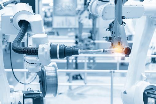 The robotics arm welding the automotive parts. 1153884061
