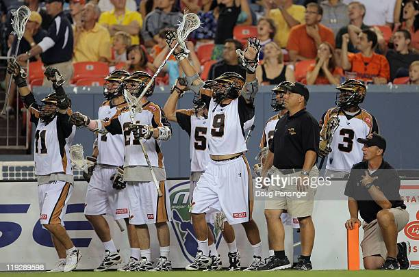 The Rochester Rattlers celebrate and head coach Tim Soudan looks on as time expires against the Denver Outlaws during their Major League Lacrosse...