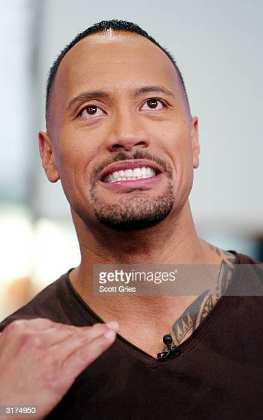 The Rock appears on stage during MTV's Total Request Live at the MTV Times Square Studios March 30 2004 in New York City