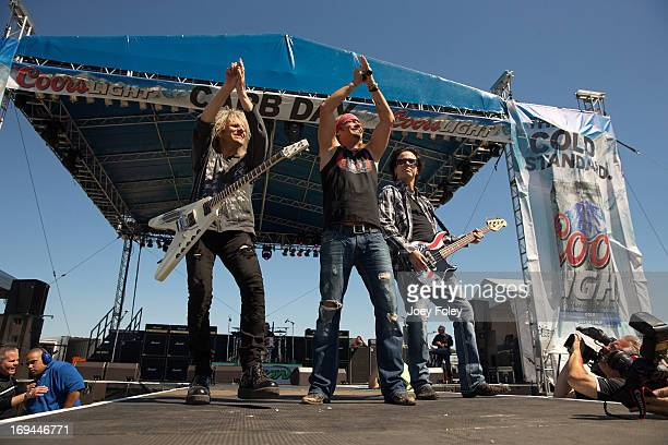 The rock band Poison performs onstage during the 2013 Indy 500 Miller Lite Carb Day concert on May 24 2013 in Indianapolis Indiana
