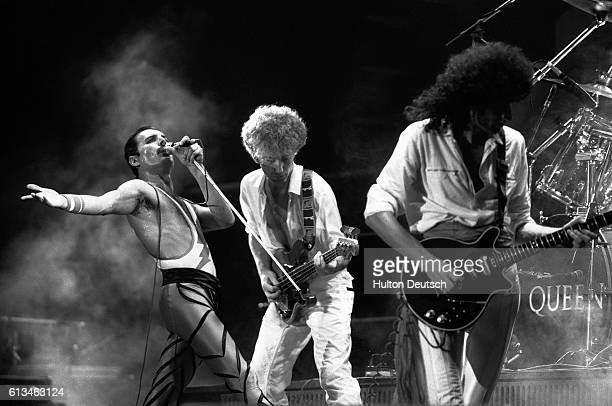 The rock band Queen in concert in 1984 lead singer Freddie Mercury John Deacon and Brian May