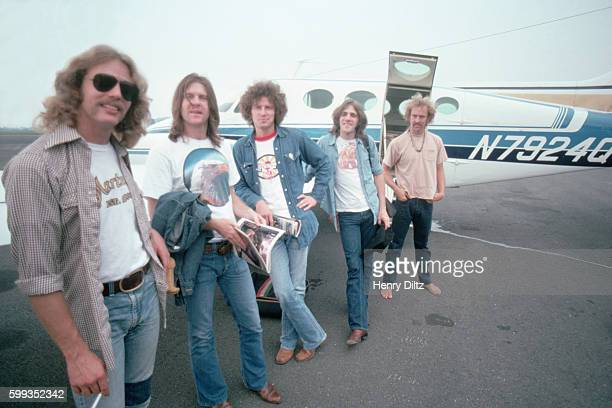 The rock band the Eagles rest against a wing of their airplane The Eagles were the most popular band of the seventies and their reunion tour in the...