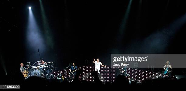 The rock band Train performs onstage at Conceso Fieldhouse on August 18 2011 in Indianapolis Indiana