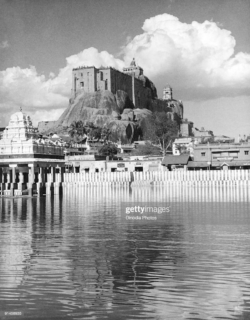 The Rock Fort Temple or Ucchi Pillayar Koil in Tiruchirappalli or Trichy, Tamil Nadu, India, 1940s. Built on a large rocky outcrop, the site actually contains two Hindu temples, dedicated to Ganesh and Shiva. In the foreground is the Teppakulam temple tank, containing a pavilion on stilts.