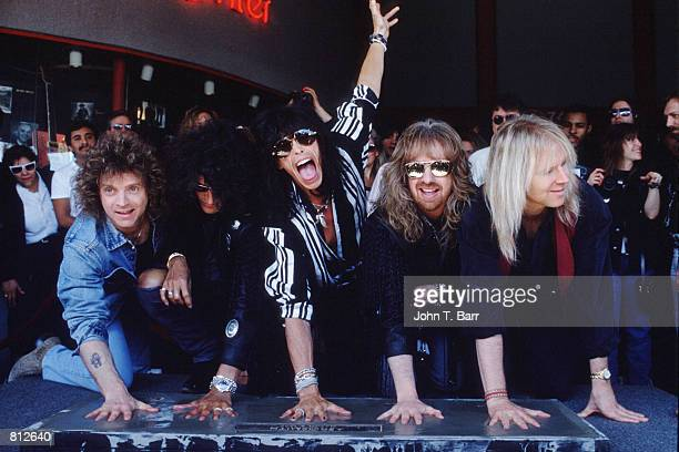 The rock group Aerosmith place their hand imprints onto the 'Rock Walk' March 6 1990 in Los Angeles CA Aerosmith was one of the most popular hard...