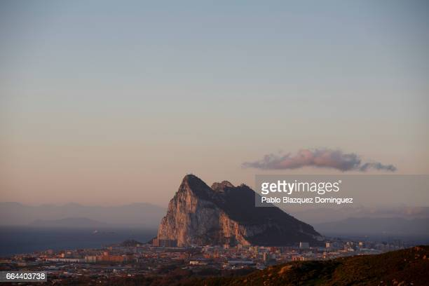 The Rock of Gibraltar stands behind La Linea de la Concepcion city on April 4 2017 in La Linea de la Concepcion Spain Tensions have risen over Brexit...