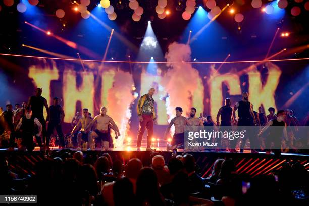 The Rock performs onstage during the 2019 MTV Movie and TV Awards at Barker Hangar on June 15 2019 in Santa Monica California