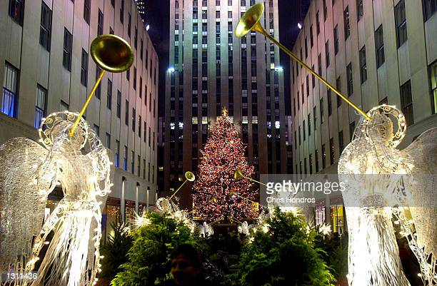 The Rockefeller Center plaza with lit statues of angels and the famous Christmas tree is ablaze with lights December 10 2000 in New York In...