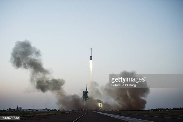 The rocket carrying Shenzhou11 spaceship blasts off in Jiuquan Satellite Launch Center on October 17 2016 in Jiuquan China China will send two...