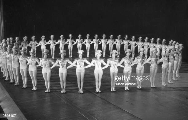 The Rockettes forming a circle on stage at Radio City Music Hall Rockefeller Center New York City