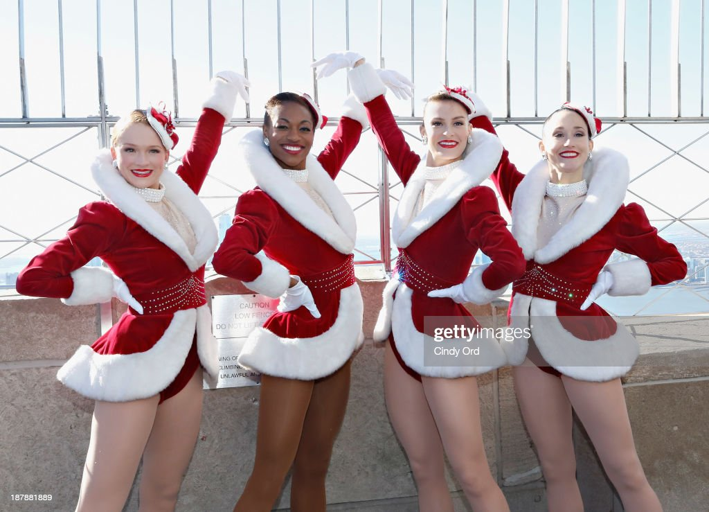 The Rockettes Light The Empire State Building Green And Red in Celebration Of The '2013 Radio City Christmas Spectacular' : News Photo