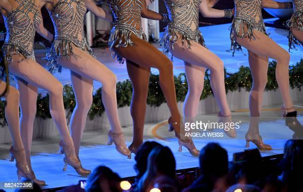 The Rockettes perform during the 85th Rockefeller Center Christmas Tree Lighting Ceremony at Rockefeller Center on November 29 2017 in New York City...