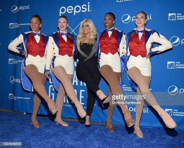 The Rockettes pose with Bebe Rexha during The Madison Square Garden Company Announcement at Madison Square Garden on July 24 2018 in New York City