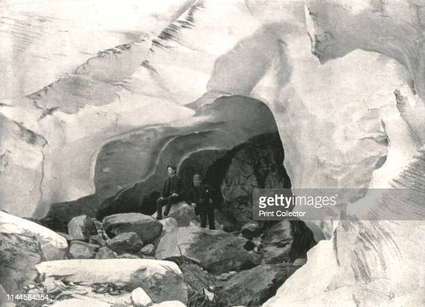 ice cave in the Great Glacier Mount Sir Donald Canada 1895 People standing at the entrance to a cave in the ice of a glacier on Mount Sir Donald in...