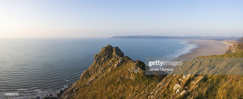 The rocky coastline at Oxwich Bay from Great Tor at sunrise on the Gower peninsula, Swansea. : Stock Photo