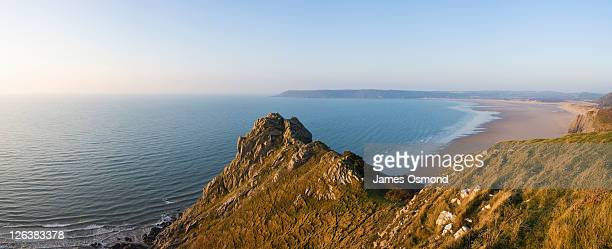 The rocky coastline at Oxwich Bay from Great Tor at sunrise on the Gower peninsula, Swansea.