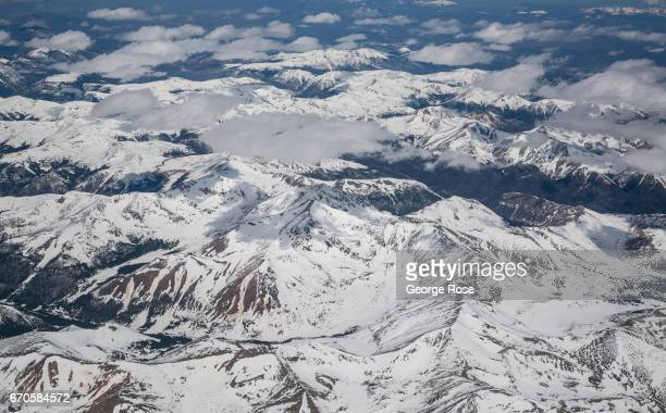 The Rocky Mountains are coated in a thick layer of late spring snow as viewed from 34000 feet on April 16 west of Denver Colorado Near Golden 23...