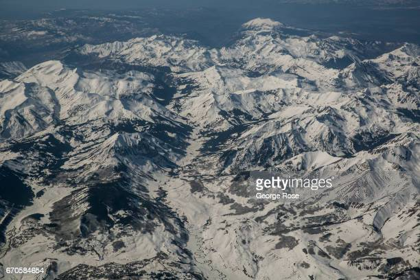 The Rocky Mountains are coated in a thick layer of late spring snow as viewed from 34000 feet on April 12 west of Denver Colorado Near Golden 23...