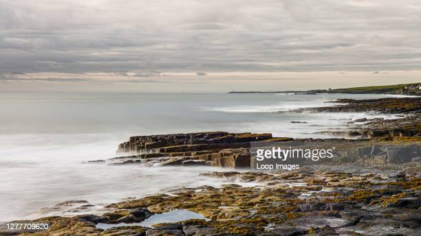 The rocky Northumberland coast just after dawn