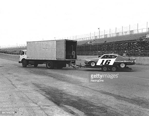 The Roger Penske AMC Matador heading for the Daytona garage area from the track crossover gate The driver was Mark Donohue and the tow rig was a box...