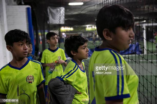 The Rohingya Cultural Center of Chicago soccer team watches teammates during a game on January 12 2019 in Chicago Illinois Chicago has one of the...