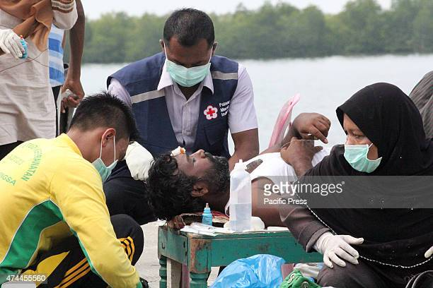 The Rohingya migrants from Myanmar and Bangladesh that were rescued by the Indonesian fishermen and brought to the Port of Kuala Langsa