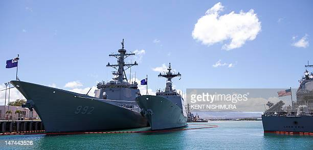 The ROKS Yulgok Yi-I and the ROKS Choi Young sit pier side opposite of the USS Lake Erie at Joint Base Pearl Harbor-Hickam for the Rim of the Pacific...