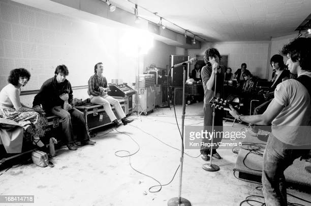 The Rolling Stones are photographed rehearsing as comedians Dan Aykroyd and Bill Murray watch in October 1978 in New York City. CREDIT MUST READ: Ken...