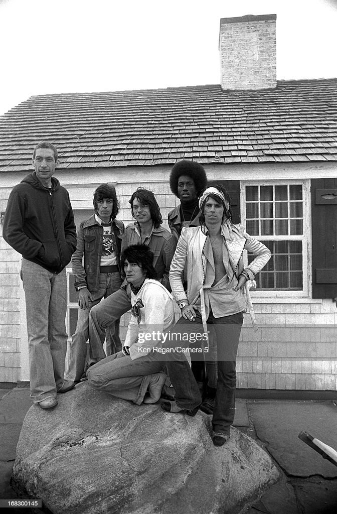 Charlie Watts, Bill Wyman, Mick Jagger, Ronnie Wood and Keith Richards) are photographed with a session musician at artist Andy Warhol's home in 1975 in Montauk, New York.