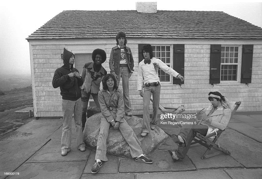Charlie Watts, Mick Jagger, Bill Wyman, Ronnie Wood and Keith Richards) are photographed with a session musician at artist Andy Warhol's home in 1975 in Montauk, New York.