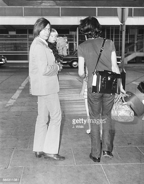 'The Rolling Stones' drummer Charlie Watts holding his young daughter Seraphina as they arrive at London Airport October 17th 1969