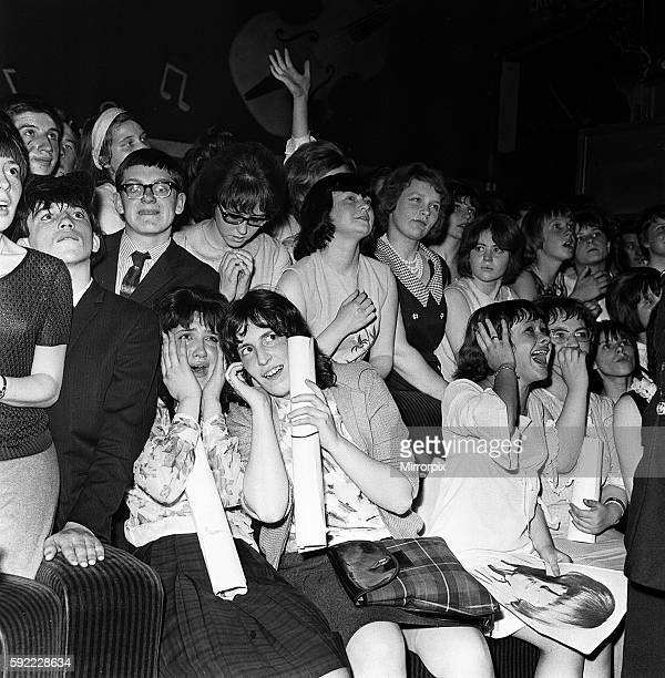 The Rolling Stones Fans scream as the Stones perform on stage at the Imperial Ballroom in Nelson Lancashire 25th July 1964