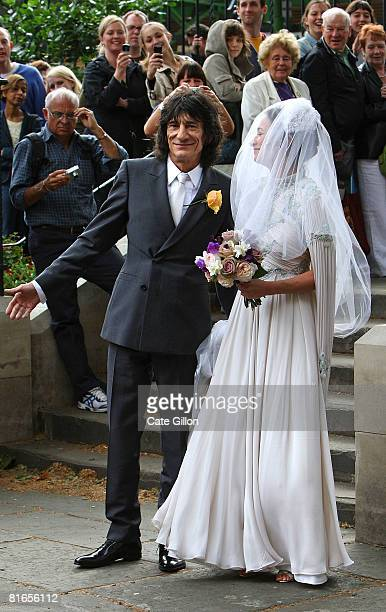 The Rolling Stones' guitarist Ronnie Wood arrives with his daughter Leah Wood for her wedding to Jack MacDonald at Southwark Cathedral on June 21...