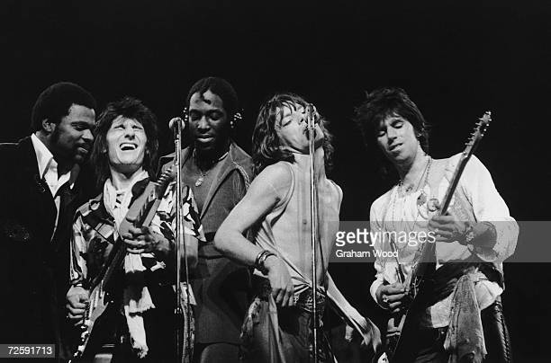The Rolling Stones headline the Knebworth Festival 21st August 1976 Left to right Keyboard player Billy Preston Giuitarist Ron Wood percussionist...