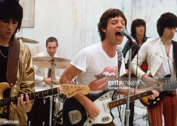 MERCHANDISING**The Rolling Stones in performance 1978 They are guitarist Ronnie Wood drummer Charlie Watts singer Mick Jagger bassist Bill Wyman and...