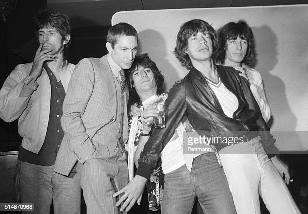 The Rolling Stones, Keith Richards, Charlie Watts, Ron Wood, Mick Jagger, and Bill Wyman ham it up for journalists at a party to promote their new...