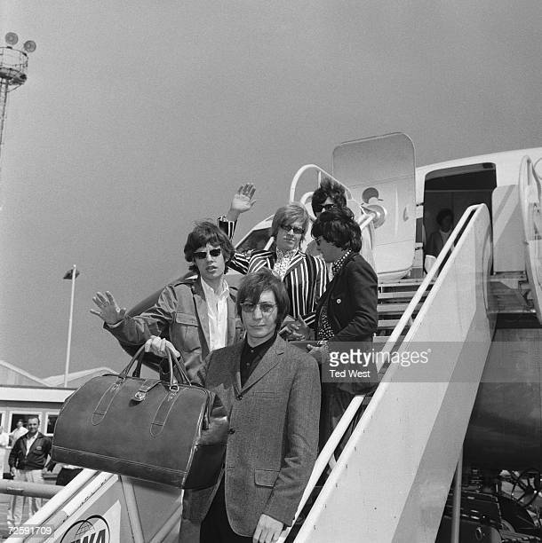 The Rolling Stones leave London Airport on a flight to New York before their fifth north American tour 23rd June 1966 Top to bottom Bill Wyman Brian...