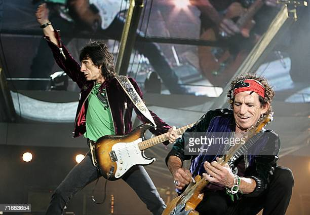 The Rolling Stones members Keith Richards and Ron Wood perform on stage at Twickenham Stadium on August 20 2006 in London England