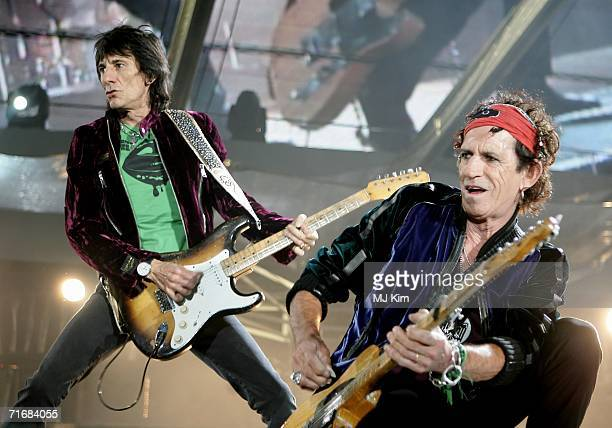 The Rolling Stones members Keith Richards and Ron Wood perform on stage at Twickenham Stadium August 20 2006 in London England