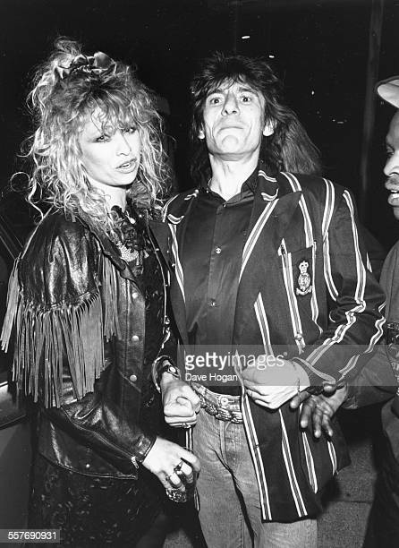 'The Rolling Stones' musician Ronnie Wood and his wife Jo, attending a party held by the singer Prince in London, July 27th 1988.