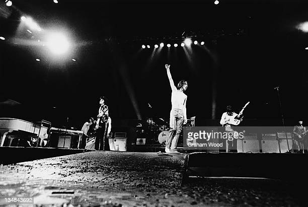 The Rolling Stones on stage at the Knebworth Festival, Hertfordshire, 21st August 1976. Left to right: Ron Wood, Mick Jagger, Keith Richards and Bill...