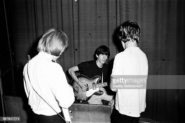 The Rolling Stones on stage during rehearsals for a BBC radio broadcast at the Playhouse Theatre London circa 1964 LR Brian Jones Keith Richards Mick...