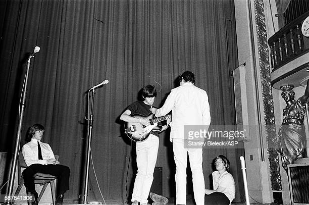 The Rolling Stones on stage during rehearsals for a BBC radio broadcast at the Playhouse Theatre London circa 1964 LR Brian Jones Keith Richards...