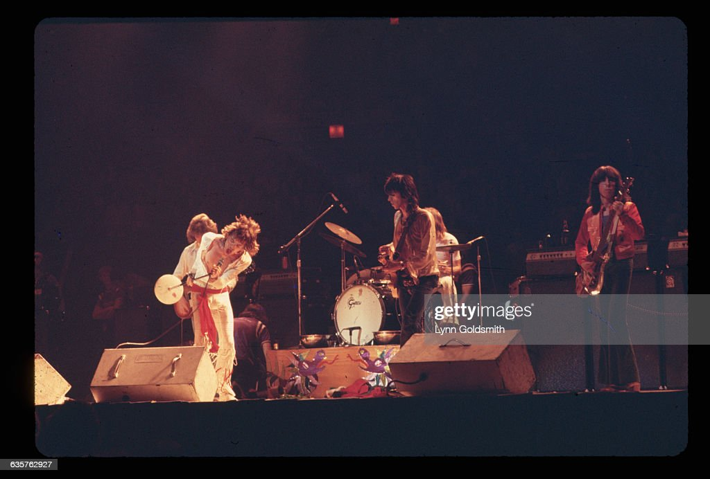 The Rolling Stones perform a concert with (from left to right): guitarist Mick Taylor, singer Mick Jagger, guitarist Keith Richards, drummer Charlie Watts, and bass guitarist Bill Wyman.
