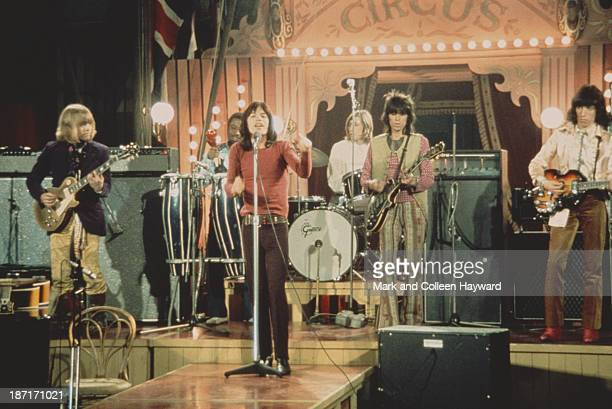 The Rolling Stones perform live on stage on the set of the Rolling Stones Rock and Roll Circus at Intertel TV Studio in Wembley, London on 11th...