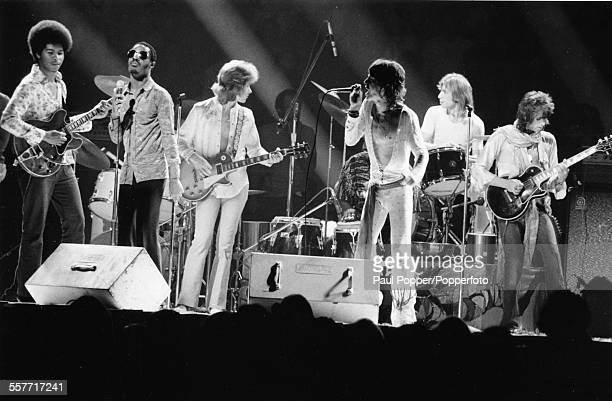 The Rolling Stones perform live on stage with Stevie Wonder at Madison Square Gardens New York July 31st 1972 From left to right unknown guitarist...