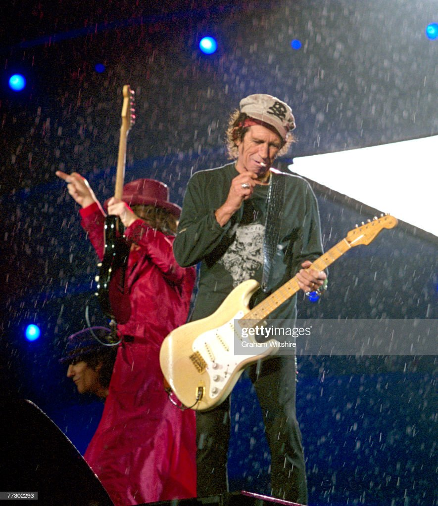 The Rolling Stones perform on a rainy night at Don Valley Stadium, Sheffield, during the 'A Bigger Bang' tour, 27th August 2006. Left to right: Ron Wood, Mick Jagger and Keith Richards.